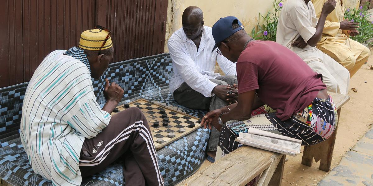 Three men playing a game